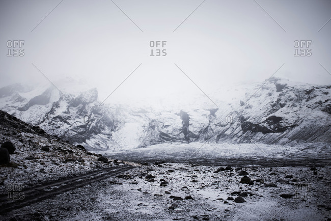 Fog covering snow covered mountains