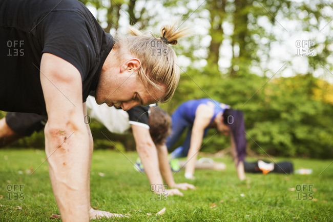 Young athletes doing push ups