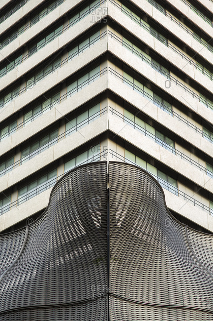 London - December 16, 2014: Modern hospital sculpture and the corner of a building tower