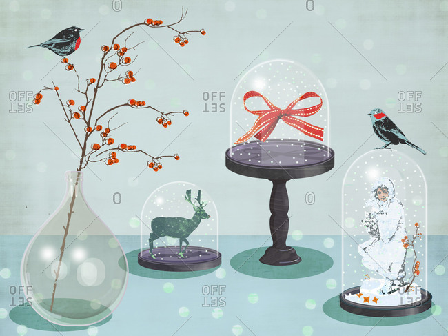 Arrangements of Christmas decorations under glass domes
