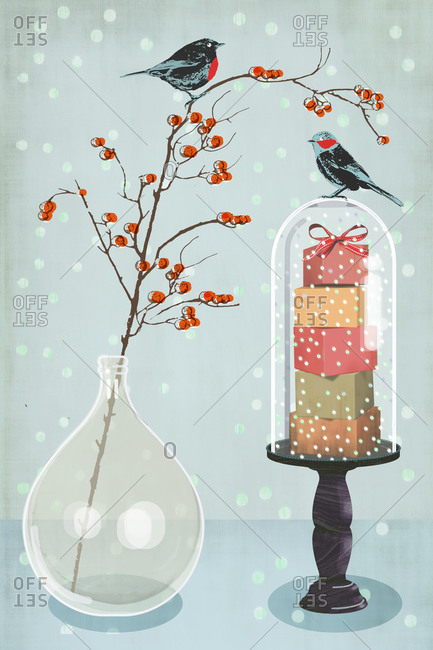 Two birds sitting on Christmas decorations