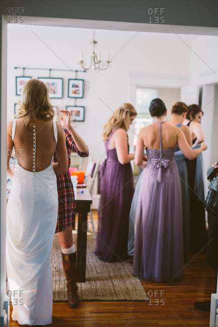 Bride and bridesmaids getting dressed for wedding
