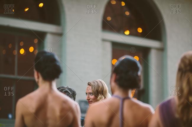 Group of women in formalwear standing outside building