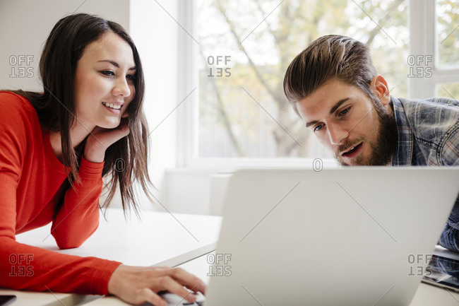 Woman and man working with devices