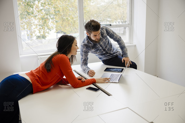 Woman and man doing project with devices