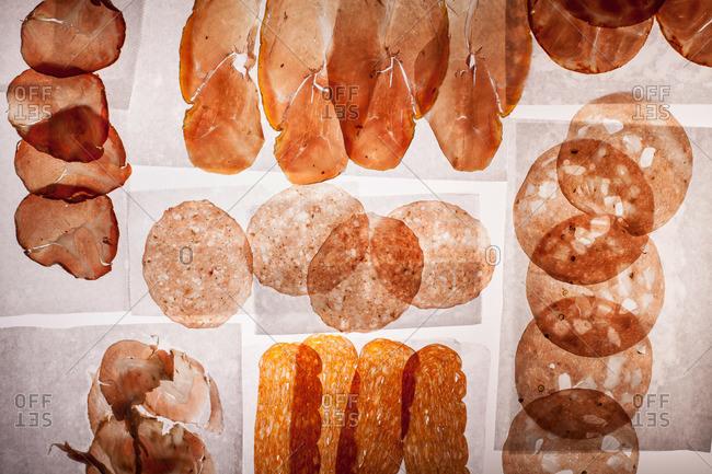 Backlit slices of cured meat