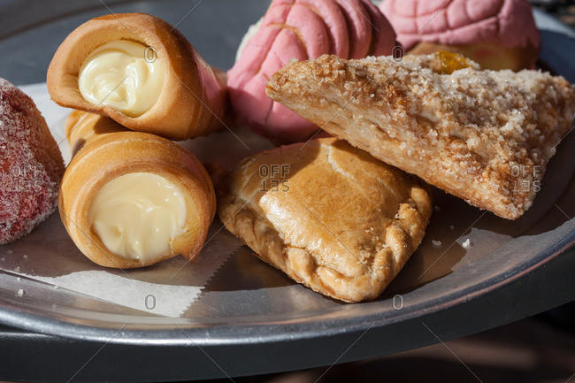 Fresh baked pasties on a metal tray