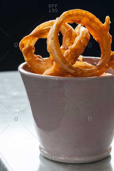 Deep fried rings in a white bowl