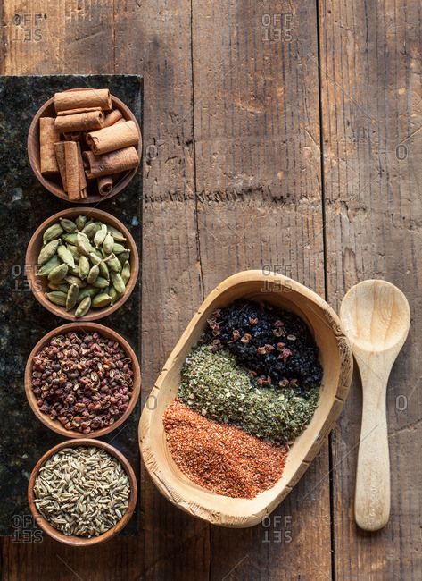 Variety of spices on a rustic wooden table