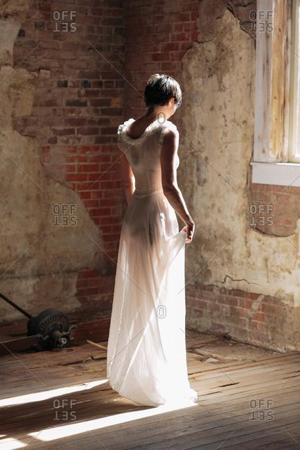 Woman in long dress in sunlight