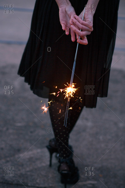 Woman in heels holding sparklers