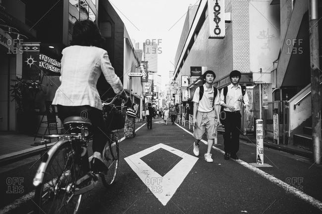 Tokyo, Japan - June 20, 2015: Pedestrians on a small Tokyo street
