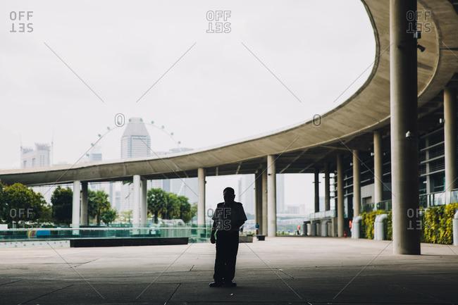 Singapore - December 31, 2014: Security guard near city overpass