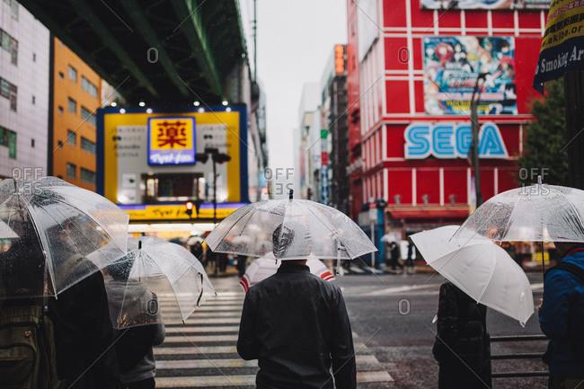 Tokyo, Tokyo - November 25, 2014: Pedestrians with umbrellas Tokyo