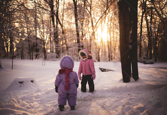 Two little girls playing in the snow