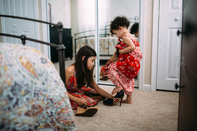 Girls trying on high heels
