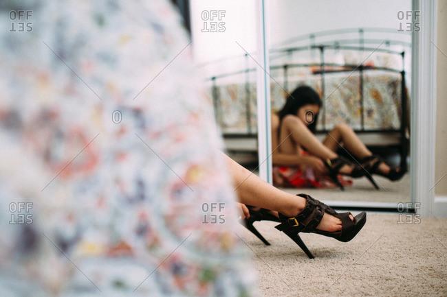 Girl trying on high heels