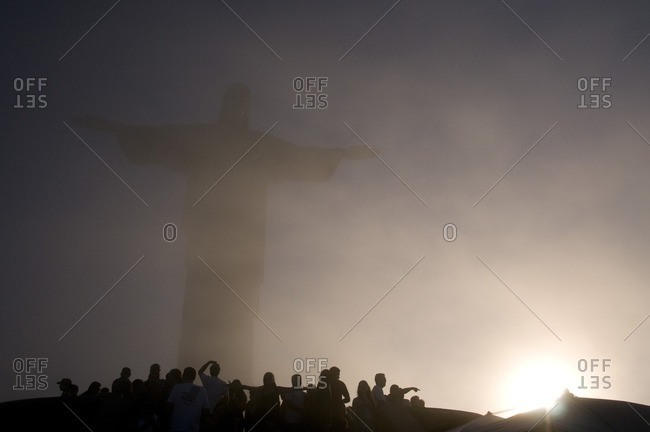Rio de Janeiro, Brazil - November 10, 2015: Christ the Redeemer in haze by tourists