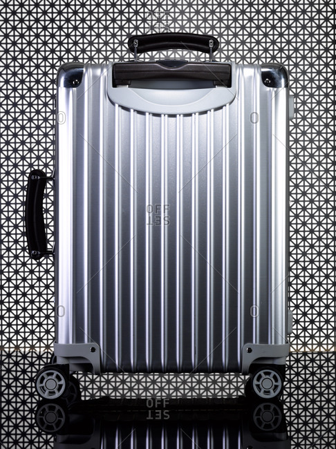 Metal luggage with intricate background