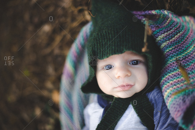 Portrait of newborn baby in green pointed knit hat