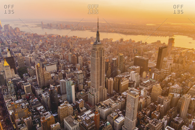New York City, NY, USA - July 11, 2015: Sunset over Manhattan and the Empire State Building, New York City, NY