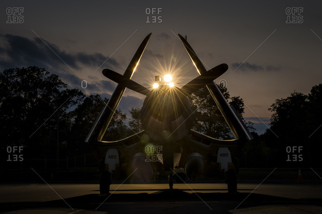 Silhouette of an old army plane at sunset at the Arsenal of Democracy, Washington D.C.