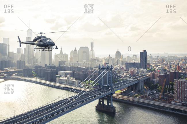 Helicopter flying over Manhattan Bridge, Manhattan, New York City, NY