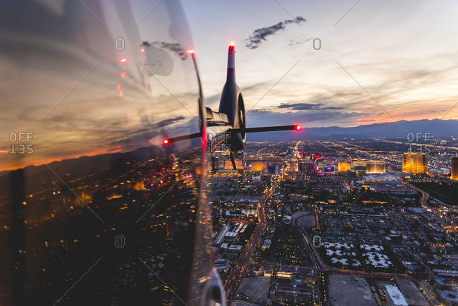 City lights reflecting on a helicopter at sunset in Las Vegas, NV
