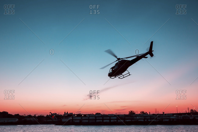 Helicopter taking off at sunset, New York City, NY