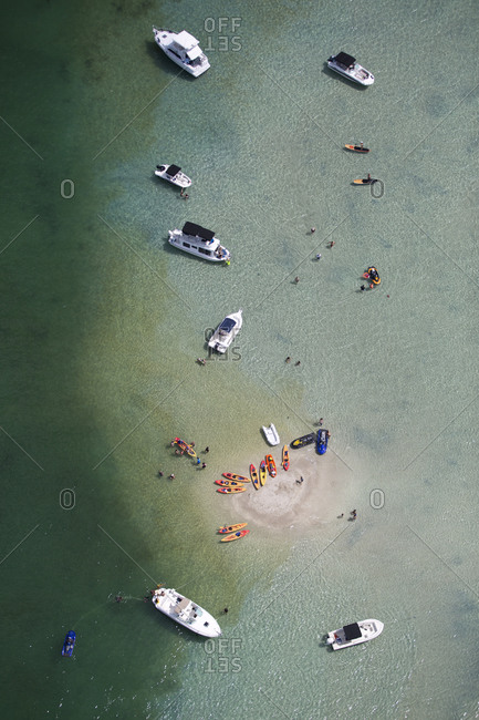 Bird's eye view of people boating of the coast of Miami, FL