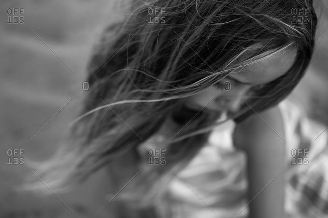 Portrait of a preteen girl with hair blowing in breeze