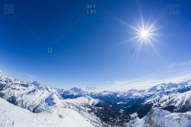 Bright sun over the Italian Alps in winter