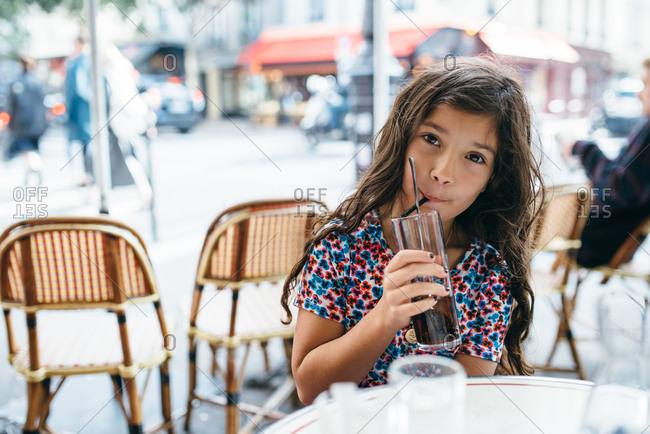 Girl drinking at outdoor Parisian caf�