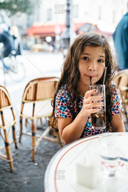 Girl drinking at a Parisian caf�