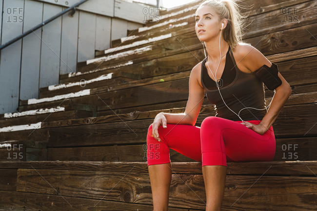 Female athlete listening to headphones