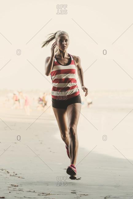 Woman jogging on a beach
