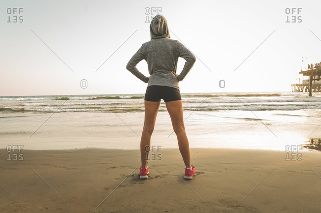 Female athlete standing on a beach