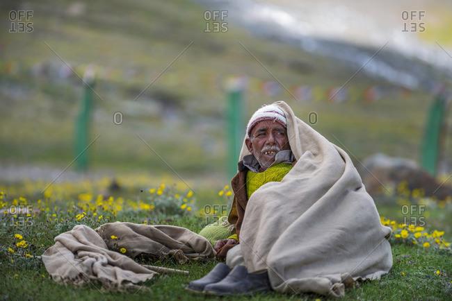 Kumzum Pass, Lahaul & Spiti, India - July 24, 2015: Nomad is sitting and relaxing, Portrait