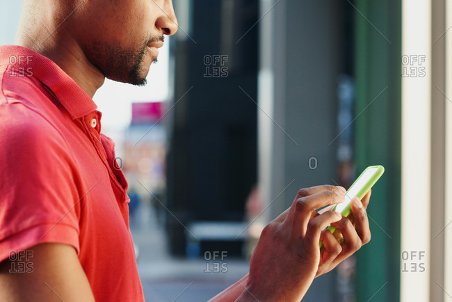 African American man using a smart phone