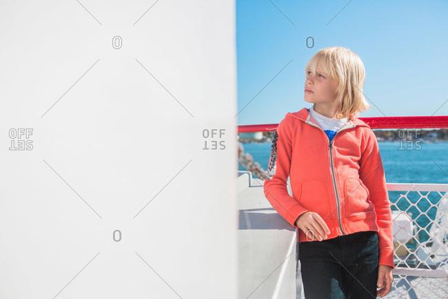 Boy leaning on a ferry