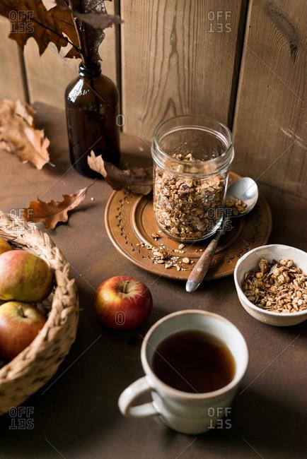 Apples near coffee and granola