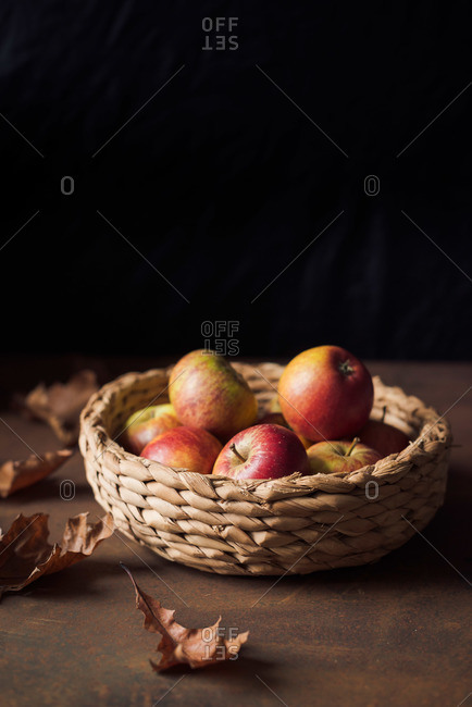 Apples in basket and fall leaves