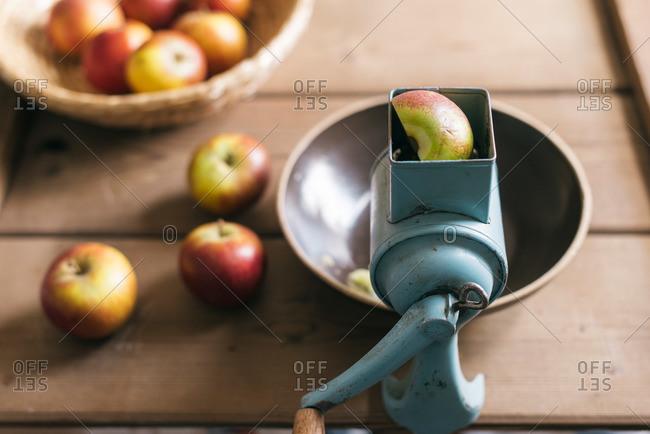 Fresh apples and apple grinder