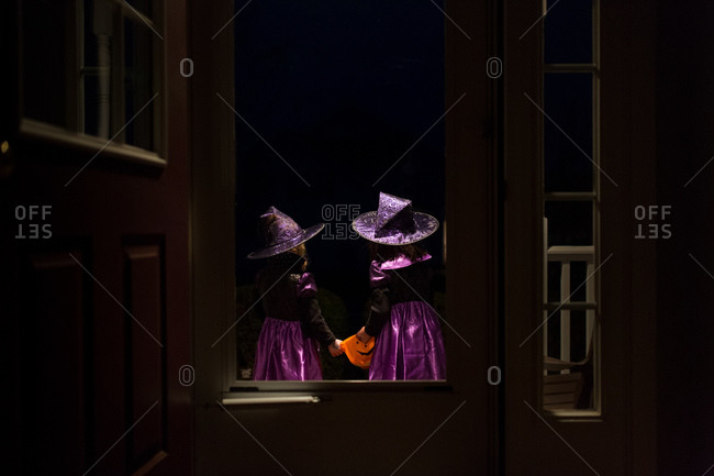 Girls in matching Halloween costumes