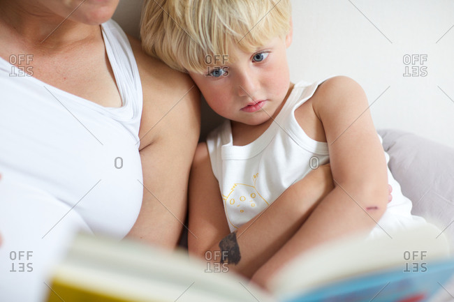 Mother reading bedtime story for son