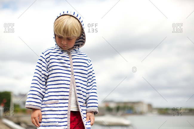 Boy looking down with curiosity