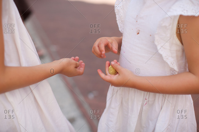 Girl giving money to her sister
