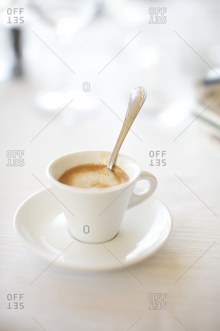 Coffee cup and saucer on table