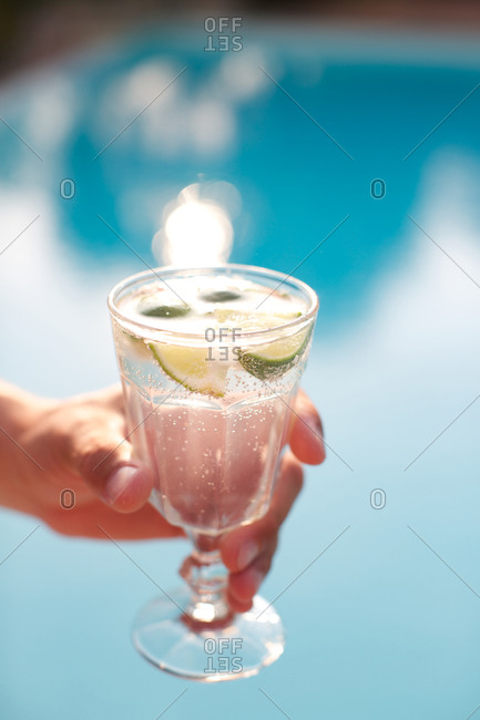 Hand holding lemon drink