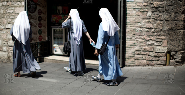 Nuns walking on street
